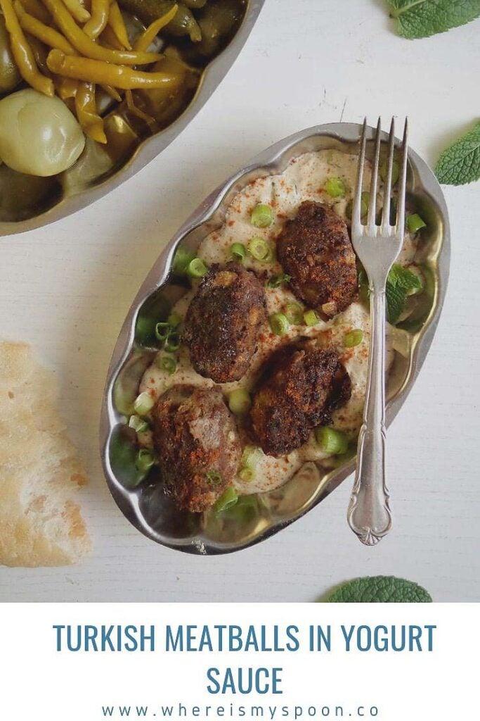 platter with turkish meat rolls in yogurt sauce