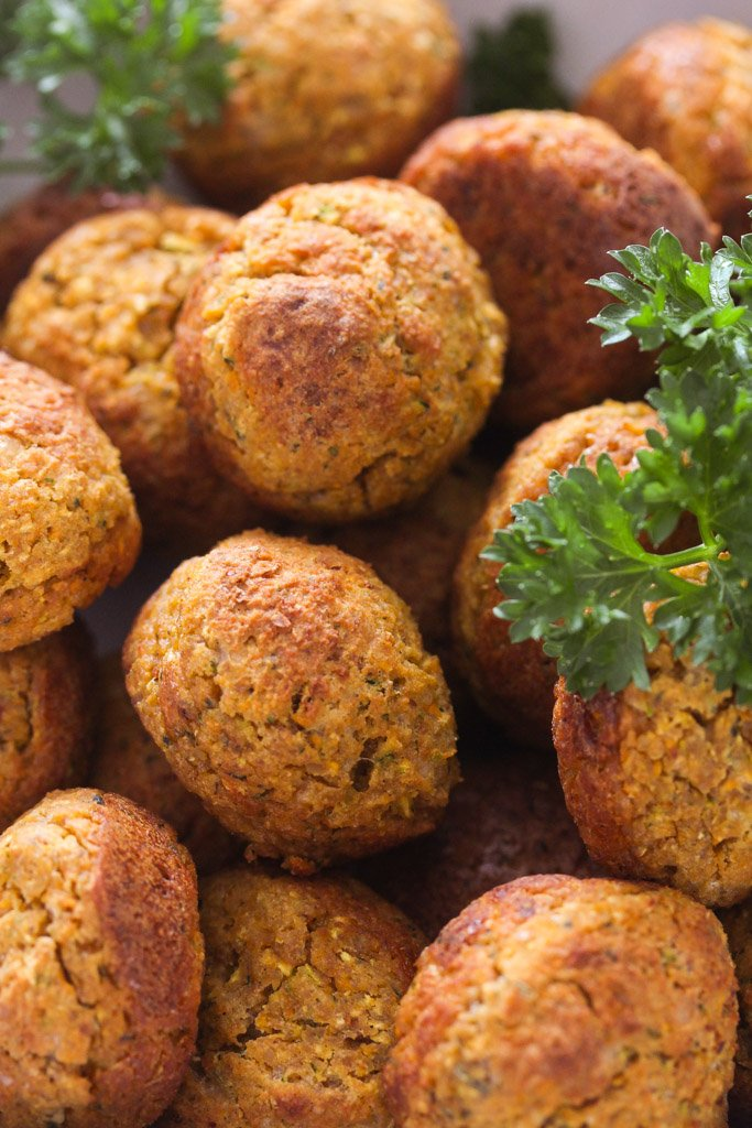 overhead view of vegetarian balls and fresh parsley.