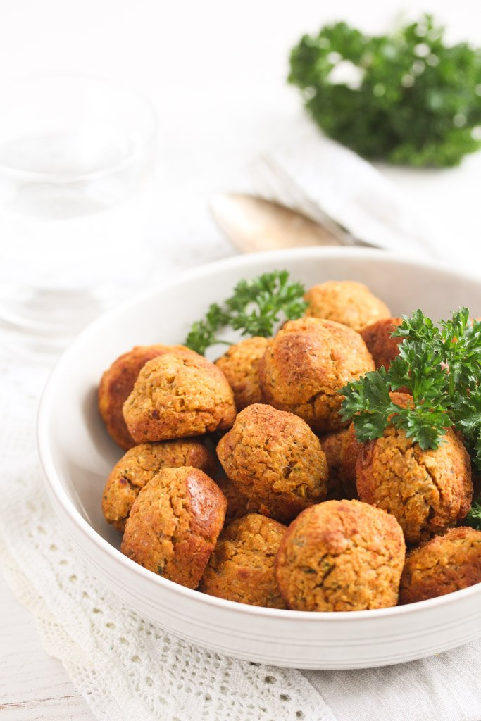 bowl with chickpea veggie balls and lots of parsley.