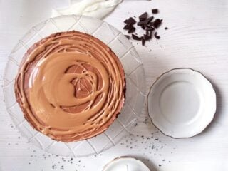 overhead image of a triple chocolate mousse cake with glaze