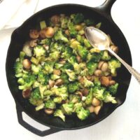 broccoli blue cheese with mushrooms in a skillet.