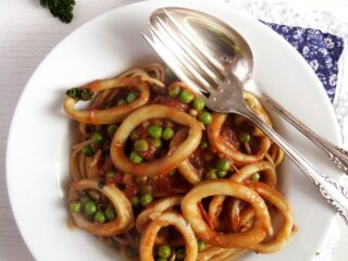mediterranean seafood pasta with peas on a plate