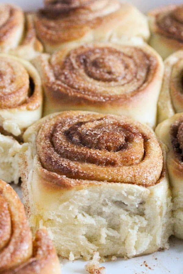 fluffy sweet rolls with cinnamon in a baking dish
