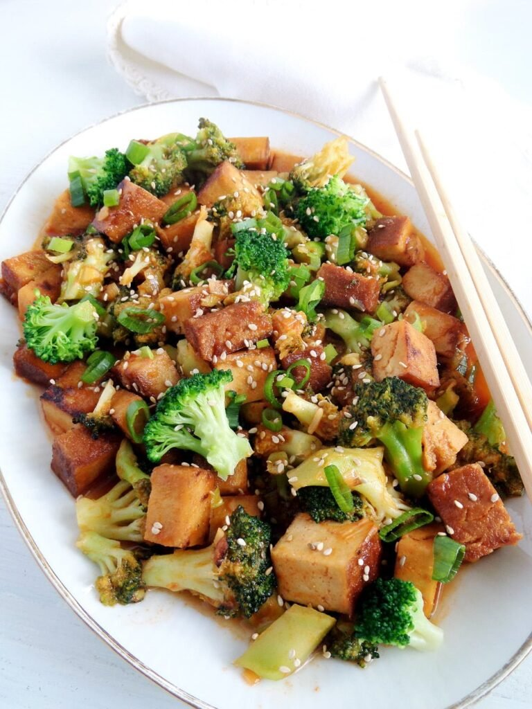sweet and sour tofu with broccoli on a platter