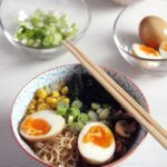 ramen bowl with the ingredients placed around the bowl