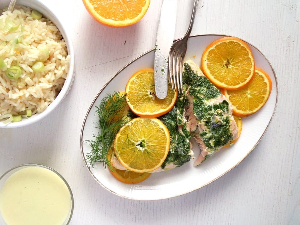 orange salmon with dill and white wine sauce served with rice
