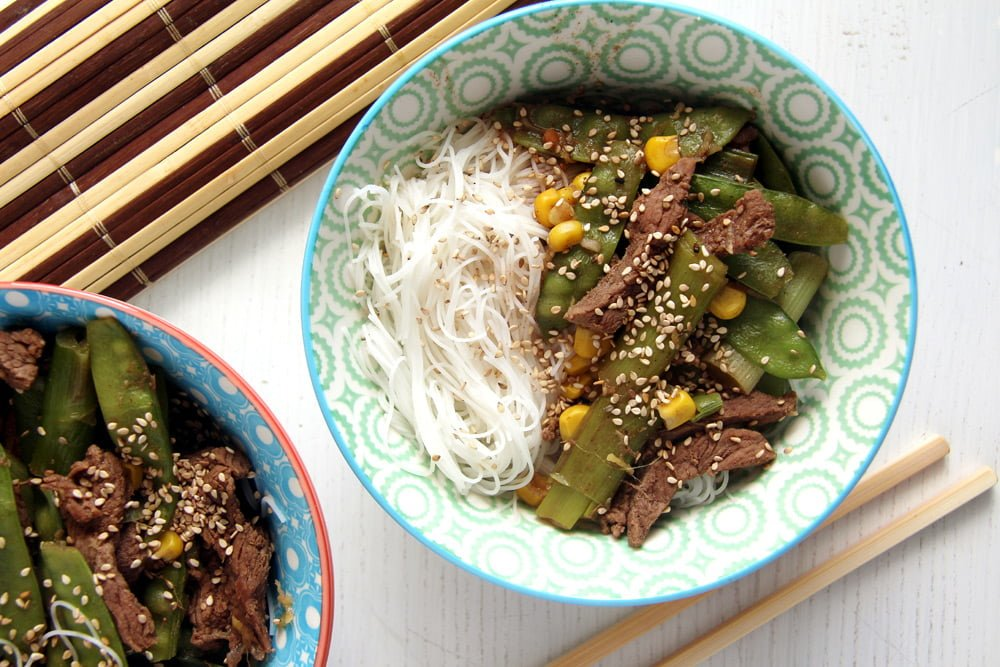 beef with noodles Aromatic Beef Rice Noodles Bowl with Green Onions