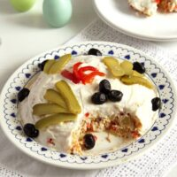 Romanian salad de boeuf decorated with mayonnaise and olives