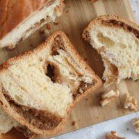 romanian sweet bread sliced on a wooden board