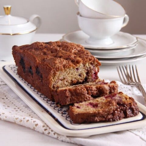 sliced rhubarb bread with blackberries