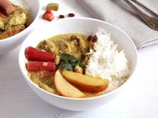 rhubarb chicken curry in a white bowl on the table