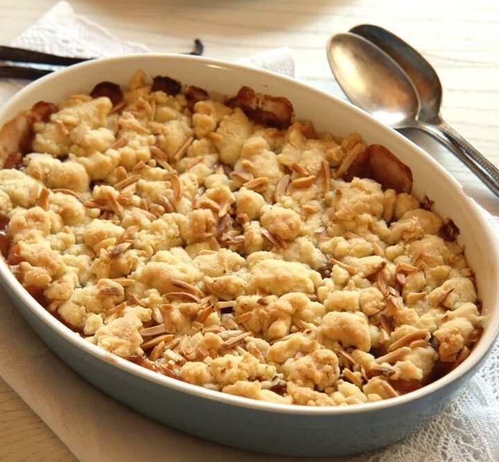rhubarb apple crumble with streusel in a blue baking dish.