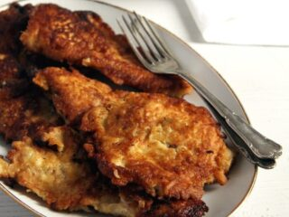 pancake battered chicken on a plate