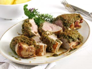 pistachio crusted pork tenderloin slightly pink in the middle