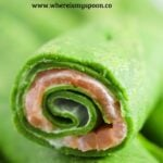 green crepes with smoked salmon filling close up