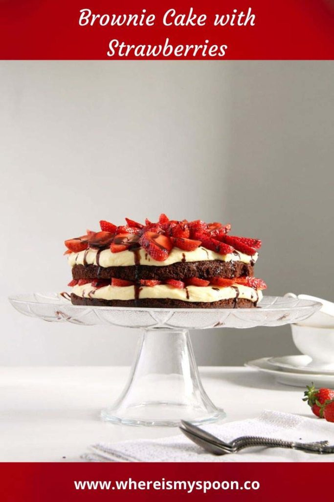 brownie cake with strawberries on a platter