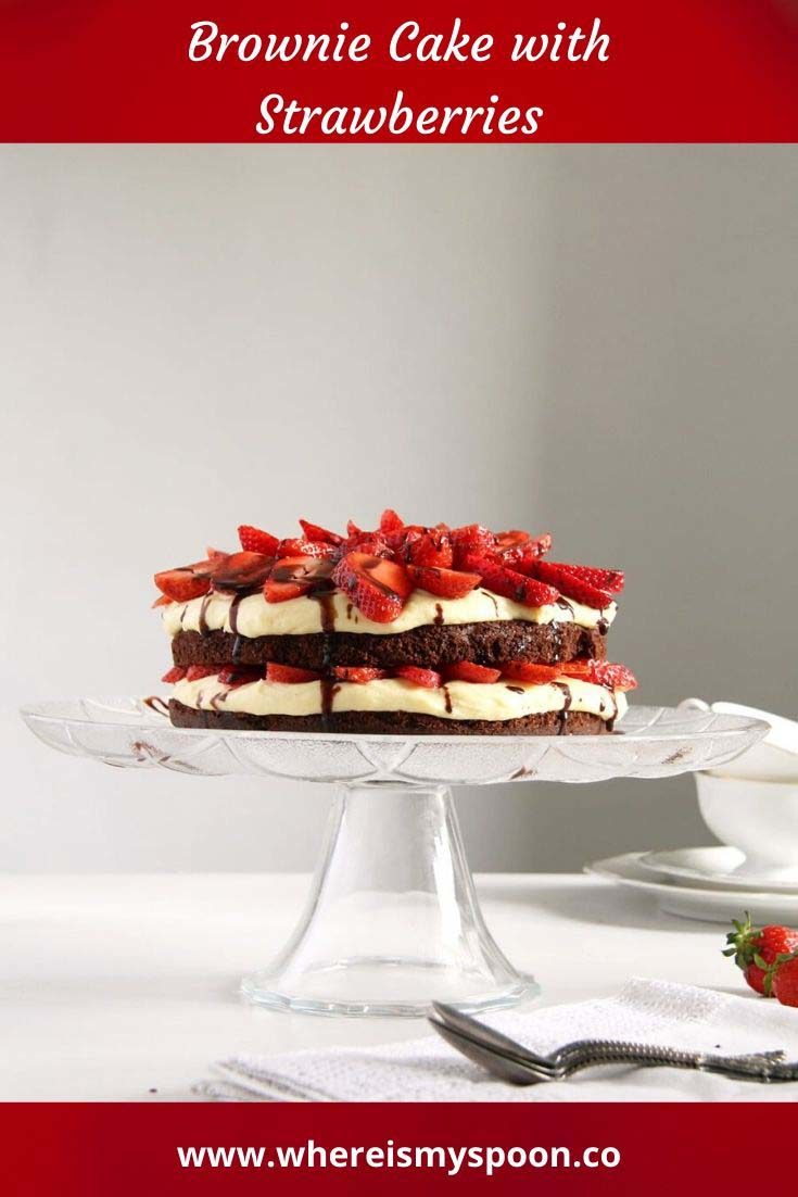 An amazingly decadent brownie cake with strawberries and a luscious cream and condensed milk filling. #whereismyspoon #browniecake #browniecakestrawberries #strawberrycake #strawberrytorte #strawberries