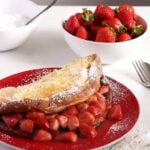 strawberry pancake on a red plate