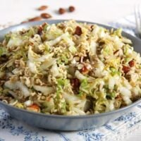 asian cabbage salad with ramen noodles in a grey bowl