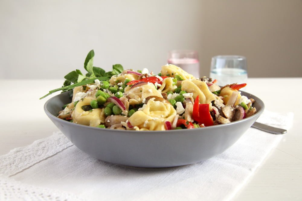 German salad with tortellini and peas