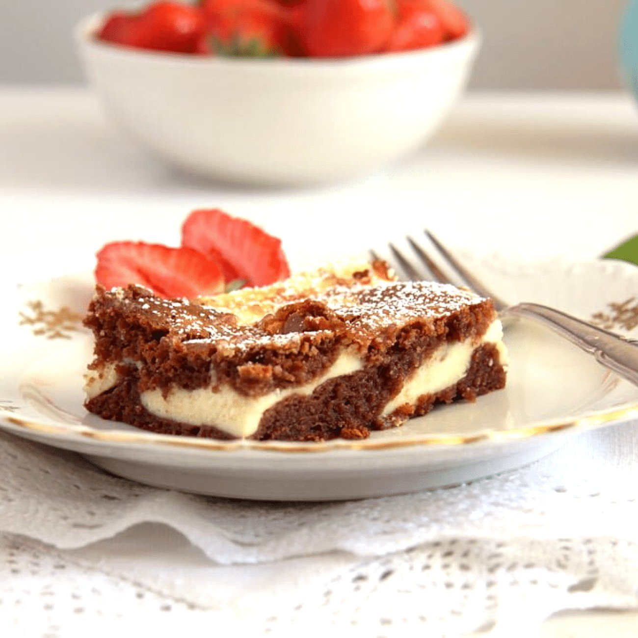 philadelphia cream cheese brownies served with fresh strawberries