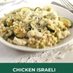 giant couscous with chicken and zucchini on a plate