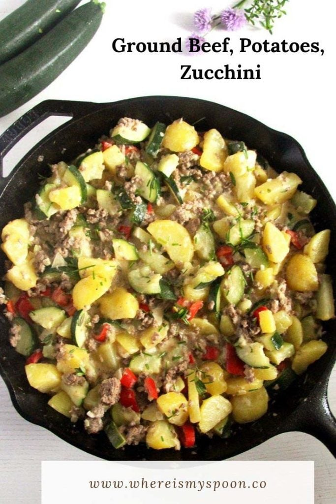 ground beef, potatoes and zucchini in a skillet