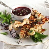 blackberry chicken on a plate decorated with fresh mint