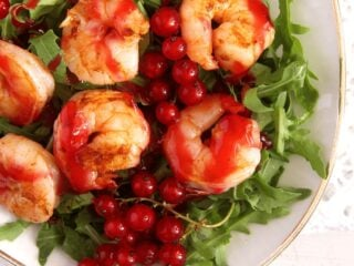 prawn salad with red currant sauce on arugula