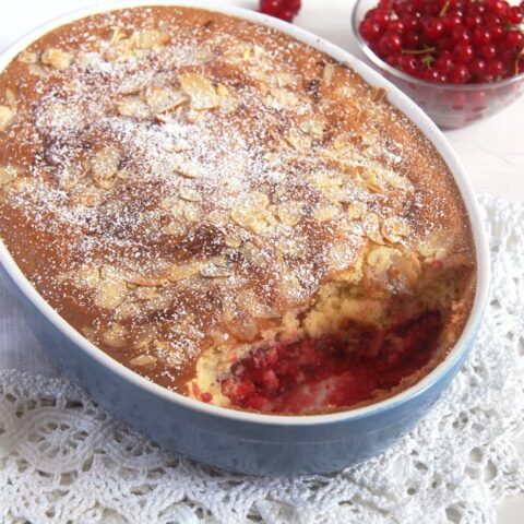 red currant dessert with dough topping in a blue baking dish