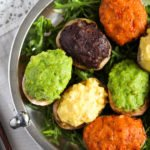 small potatoes filled with colorful fillings.