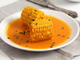 corn in coconut milk on a plate