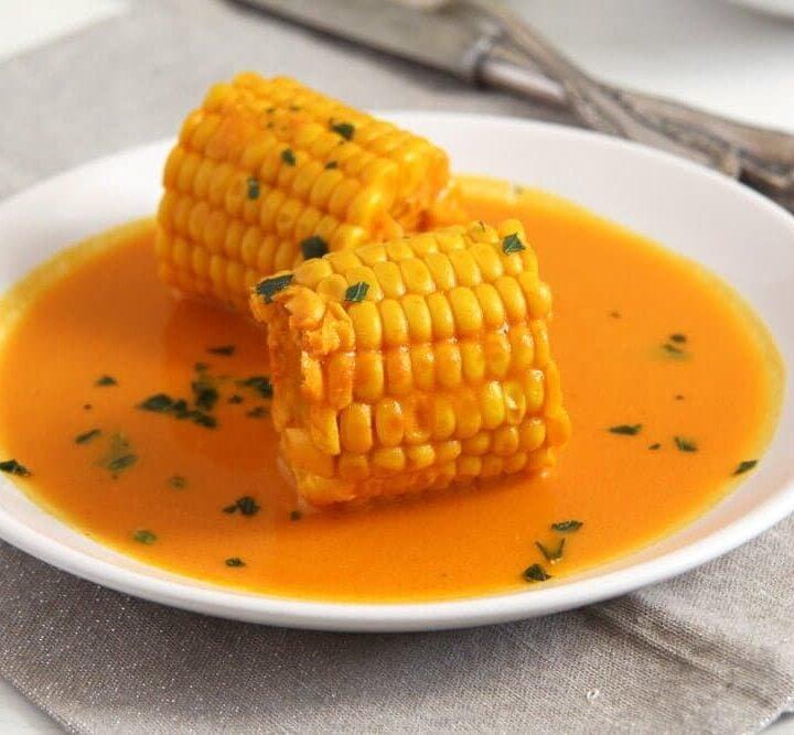 corn in coconut milk on a plate