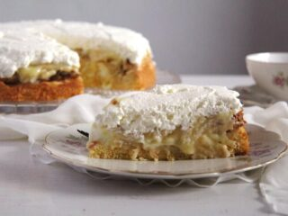 slice of german apple cake with cream