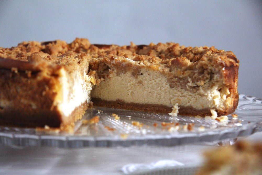 apple streusel cheesecake cut in the middle