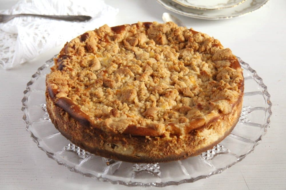 apple crumb cheesecake on a platter