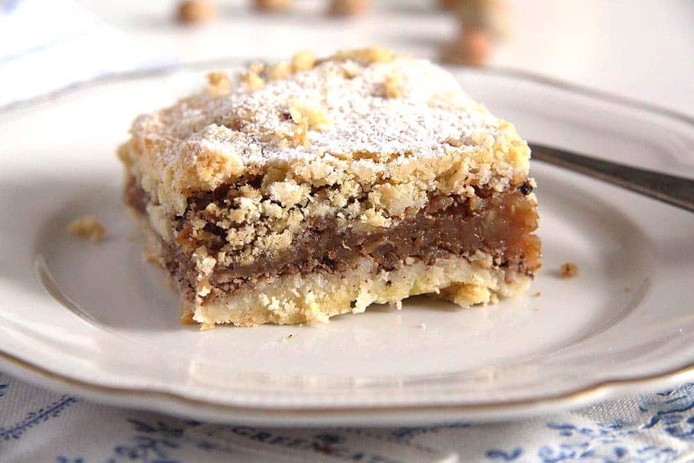 slice of hazelnut apple pie on a plate