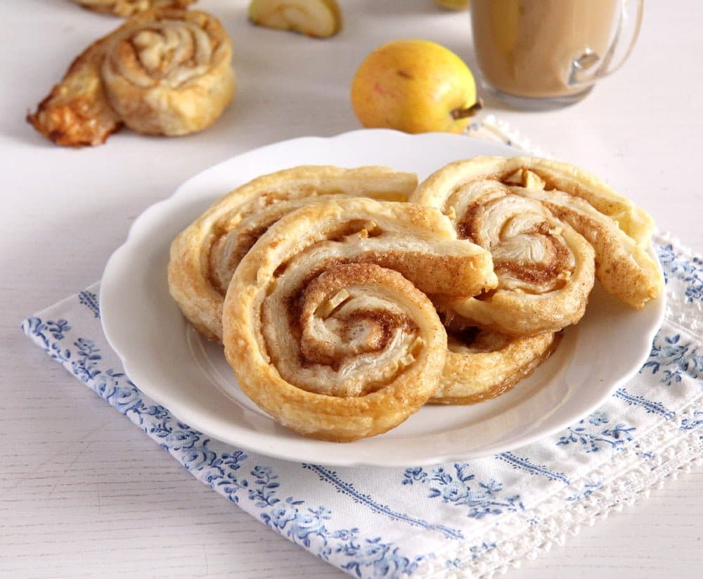 apple pastries with cinnamon on a small white plate
