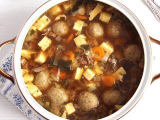 vintage serving bowl with german beef soup with dumplings
