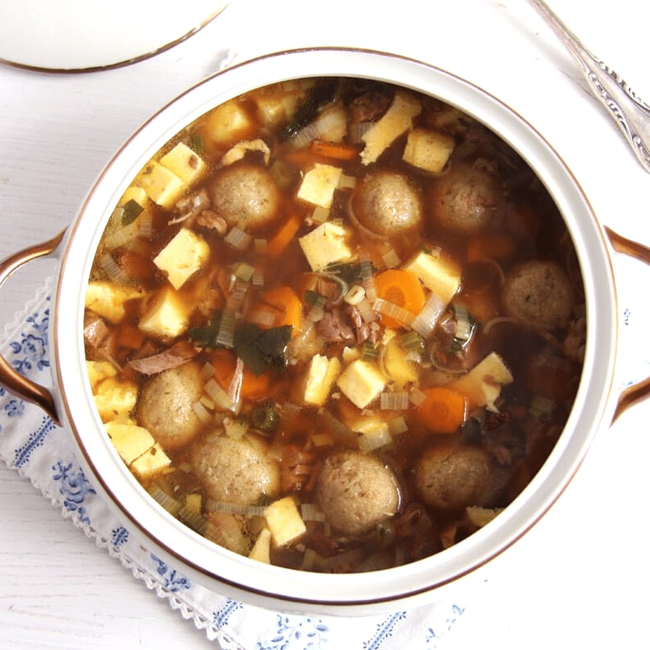 vintage serving bowl with german beef soup with dumplings