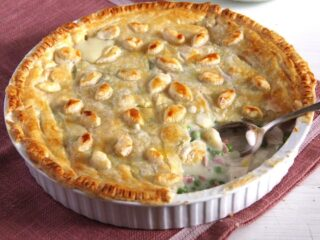 chicken and ham pie in a pie dish