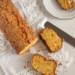 sliced pumpkin bread with almonds on a vintange white cloth