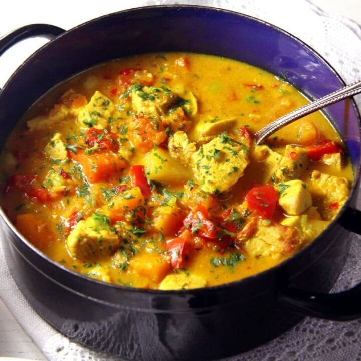 creamy turkey curry with coconut milk in a small blue pot