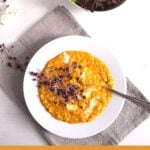 golden risotto with pumpkin and salad on the table
