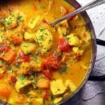 curry with butternut squash and turkey pieces in a pot