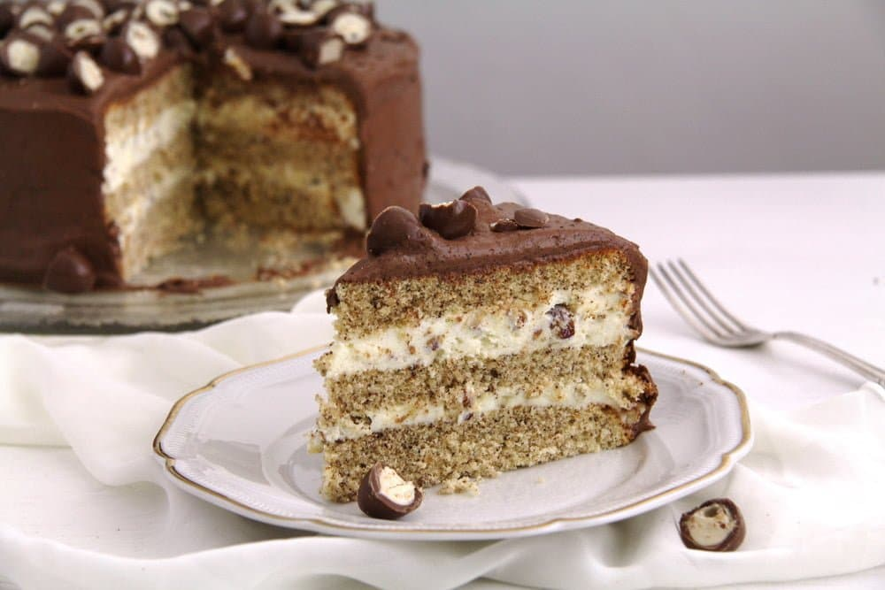 slice of layered hazelnut torte with sweetened condensed milk filling