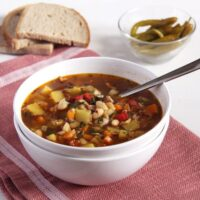 bone broth vegetable soup in a white bowl
