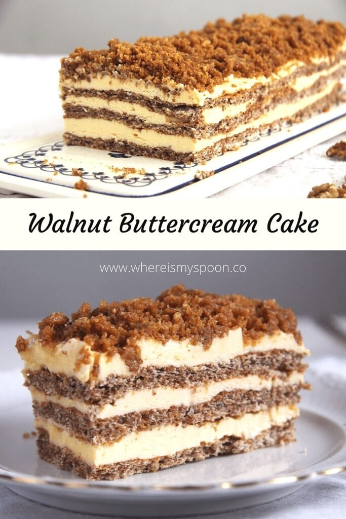 layered cake with buttercream and nuts on a platter