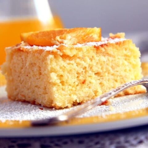 cornmeal cake with orange juice in the back