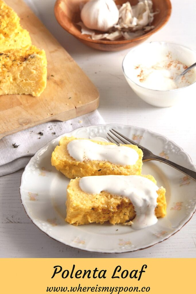 two slices of baked polenta served with yogurt sauce